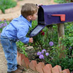 boy looking inside mailbox