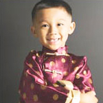 boy wearing Chinese outfit