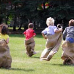 children doing a potato sack race