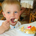 Child eating dessert in a restaurant