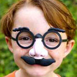 Boy wearing funny glasses
