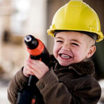 boy wearing construction hat