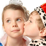 little boy prince kissing little girl princess