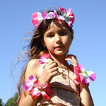 girl dressed in Hawaiian skirt and lei
