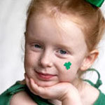 girl with green shamrock on her face