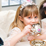 little girl at a tea party